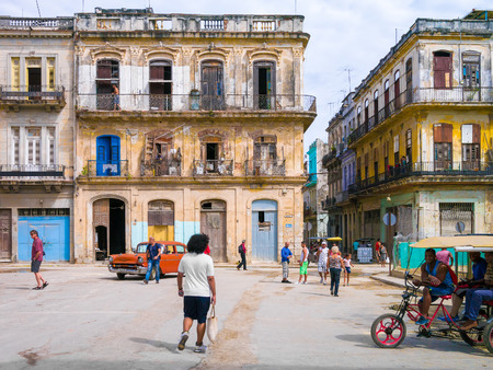 decaying: Street scene in a shabby street in Havana with people and decaying buildings