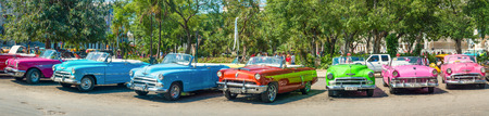 havana: Group of colorful vintage cars parked in Old Havana