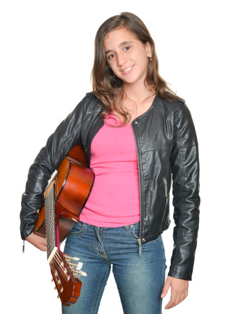pop star: Trendy hispanic teenage girl carrying a guitar isolated on white