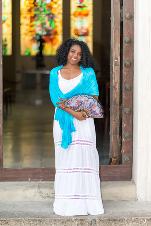 afro caribbean ethnicity: Beautiful young black cuban woman wearing a traditional dress Stock Photo
