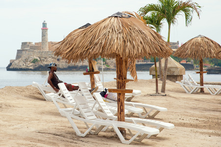 resembling: Art installation resembling a tropical beach at the Havana Biennale
