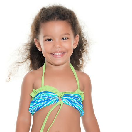 Cute small hispanic girl wearing a swimsuit isolated on white Stock Photo