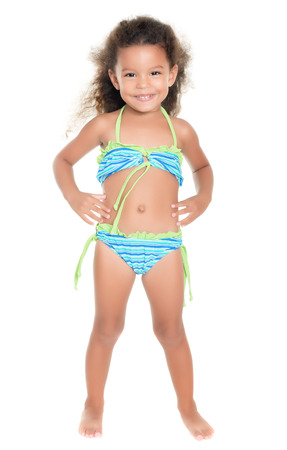 little girl swimsuit: Cute small hispanic girl wearing a swimsuit isolated on white Stock Photo