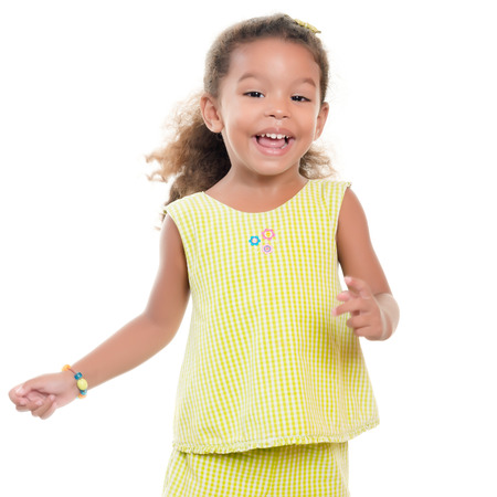 afro caribbean ethnicity: Cute small african-american or hispanic girl laughing and having fun isolated on white Stock Photo