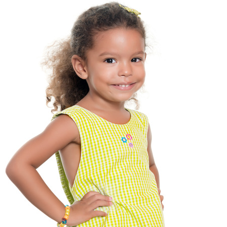 africanamerican: Portrait of a pretty small african-american or hispanic girl smiling isolated on white