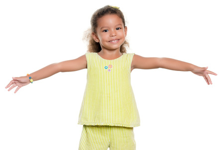afro caribbean: Small african-american or hispanic girl smiling with her arms wide open isolated on white Stock Photo