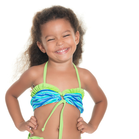 black bikini: Cute and funny small african-american or hispanic girl wearing a swimsuit isolated on white Stock Photo