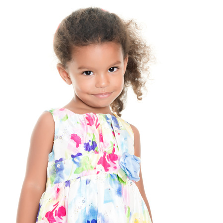afro caribbean ethnicity: Beautiful small african-american or hispanic girl wearing a flowers summer dress isolated on white
