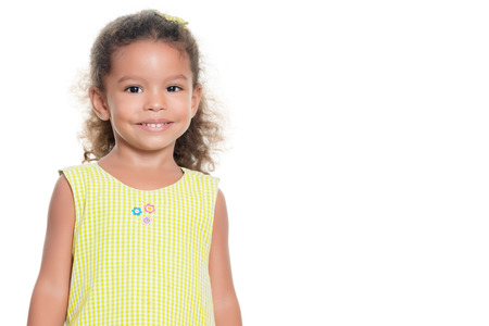 child portrait: Portrait of a pretty small african-american or hispanic girl smiling isolated on white
