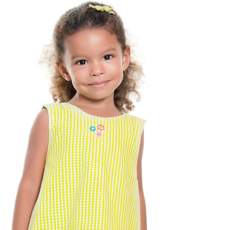 afro caribbean ethnicity: Portrait of a pretty small african-american or hispanic girl smiling isolated on white