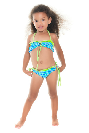 mixed race children: Cute and funny small african-american or hispanic girl wearing a swimsuit isolated on white Stock Photo