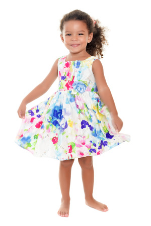 barefoot girls: Beautiful small african-american or hispanic girl wearing a flowers summer dress isolated on white