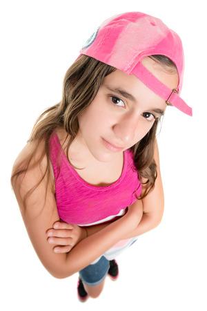 fisheye: Teenage girl with an attitude wearing a baseball cap, fisheye portrait isolated on white Stock Photo