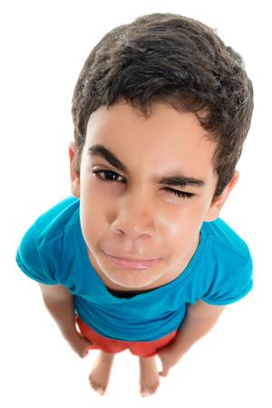 fisheye: Small boy with a sad face, fisheye portrait isolated on white Stock Photo