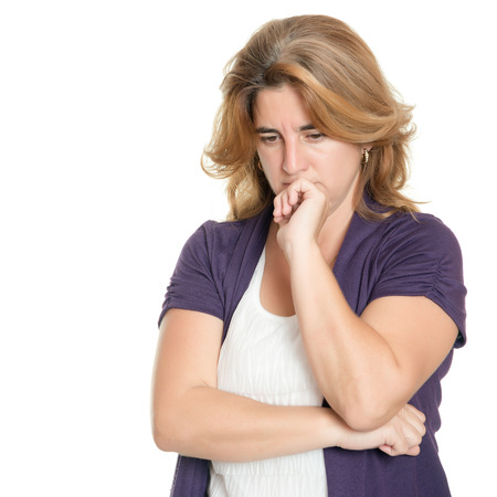 woman isolated: Portrait of a worried woman isolated on a white background