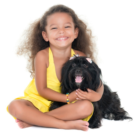 pet  animal: Cute small girl hugging her pet dog isolated on white