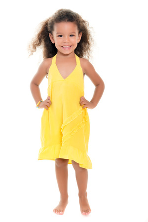 africanamerican: Cute small african-american or hispanic girl wearing a yellow summer dress isolated on white Stock Photo