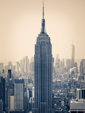 cityscapes: Split toned image of New York with the Empire State Building on the foreground