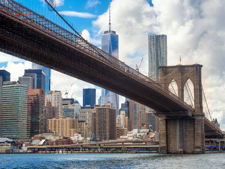 downtown manhattan: The skyline of Manjattan with the Brooklyn Bridge on the foreground Stock Photo