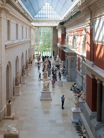 history architecture: Visitors admiring classic european art at the Metropolitan Museum of Art in New York