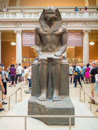 egyptian pharaoh: NEW YORK,USA - AUGUST 14,2015 : Sculpture of an egyptian pharaoh at the lobby of the Metropolitan Museum of Art in Manhattan Editorial