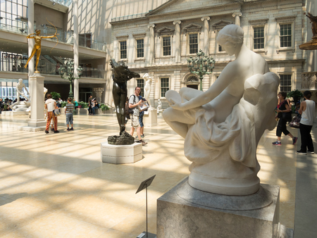 art museum: Visitors admiring classic sculptures at the Metropolitan Museum of Art in New York