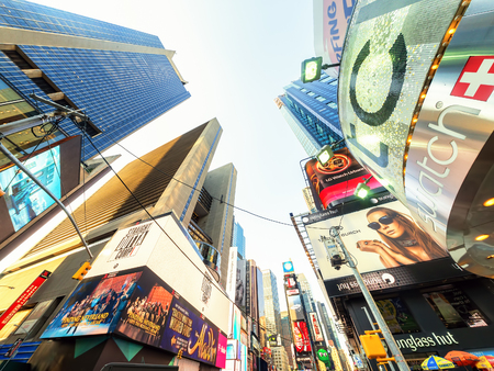 advertise with us: Skyscrapers and billboards at Times Square in New York Editorial