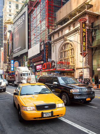 yellow cab: An iconic New York Yellow cab in the traffic of 42nd street in downtown New York