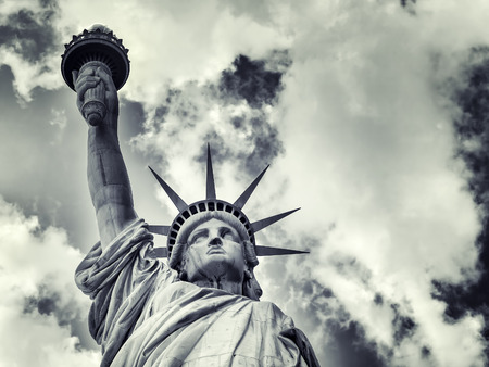 The Statue of Liberty with a dramatic cloudy sky Archivio Fotografico
