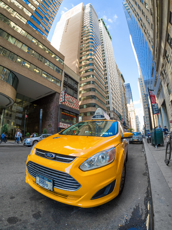 yellow cab: An iconic yellow cab parked in Broadway in downtown New York