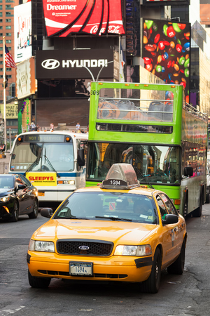 yellow cab: An iconic New York Yellow cab at Times Square in downtown Manhattan