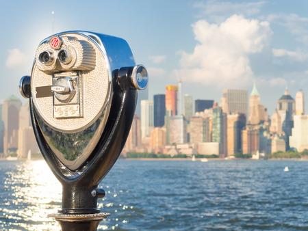 binoculars view: Observation deck with binoculars, view of the Manhattan skyline, New York City