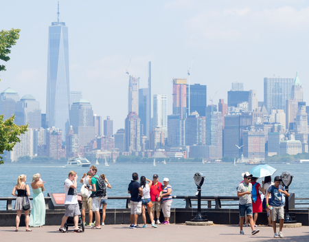 liberty island: Tourists admiring the New York skyline from Liberty Island Editorial