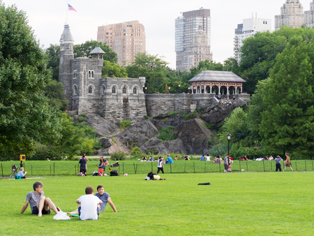 People enjoying their free time at Central Park with Belvedere Castle on the background Editorial