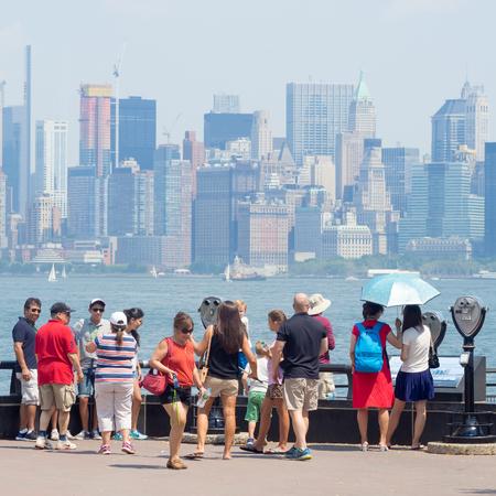 liberty island: Tourists looking at the Manhattan skyline from Liberty Island Editorial