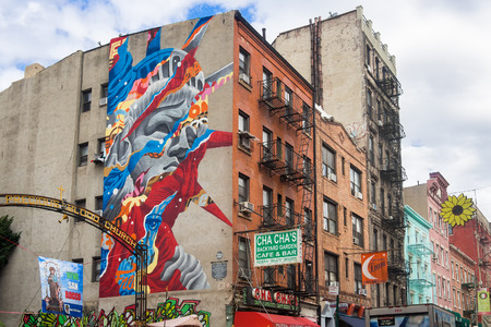 statue: Graffiti of the Statue of Liberty at historic Little Italy in New York Editorial