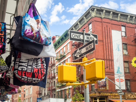 Souvenirs for sale at a street with old historic buildings in New York Editorial