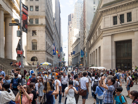 federal hall: Tourists at Wall Street near the Federal Hall in New York City Stock Photo