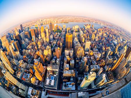Fisheye aerial view of New York City at sunset