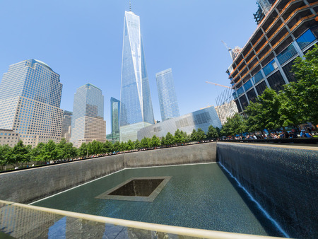 freedom tower: The 911 Memorial in New York City with the Freedom Tower on the background