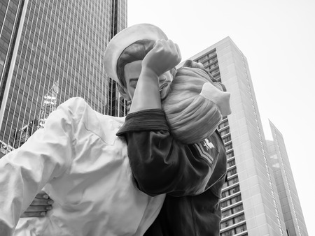 vintage photo: Figure resembling the famous photograph of a sailor kissing a nurse at Times Square in New York City