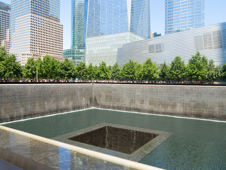 waterfall in the city: Cascades at the  911 Memorial situated where the Twin Towers once stood in New York City Editorial