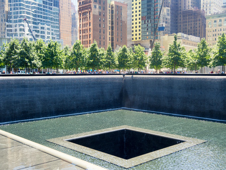 september 11: The 911 Memorial situated where the Twin Towers once stood in New York City Editorial