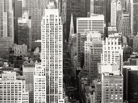 fifth avenue: Black and white view of New York City with a view of Saint Patricks Church and the skyscrapers along Fifth Avenue Stock Photo