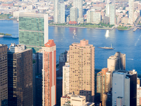 united nations: New York City architecture and the Hudson River with a view of the United Nations Building Stock Photo