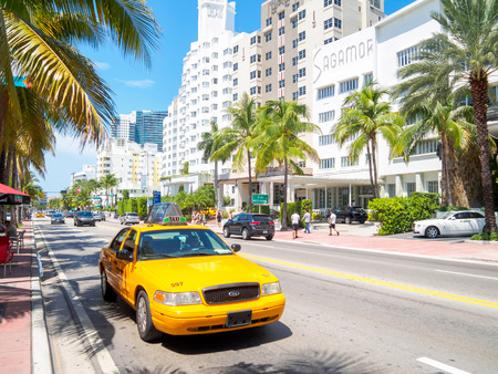 delano: Art Deco hotels and traffic on a sumer day at Collins Avenue in Miami Beach Editorial