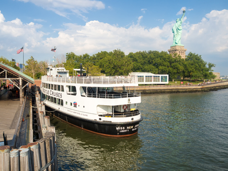 statue: Cruise ships carrying tourists to see the Statue of Liberty in New York City Editorial