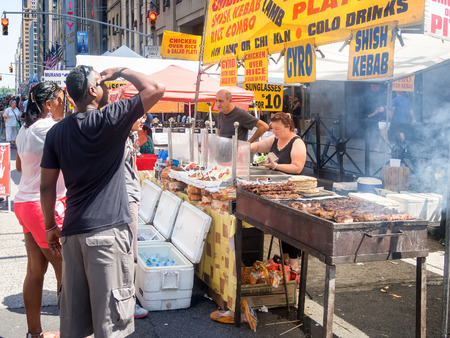 ethnic food: Street kiosk selling ethnic food at a street fair next to the Rockefeller Center in New York City