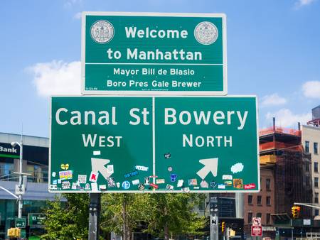 bowery: Welcome to Manhattan sign next to Chinatown in New York City