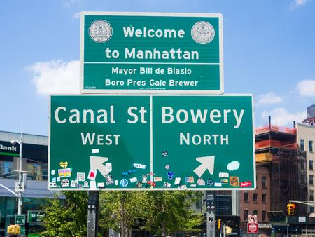 chinatown: Welcome to Manhattan sign next to Chinatown in New York City
